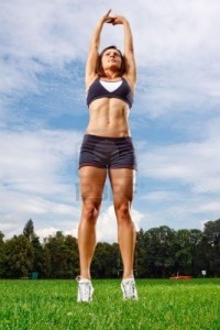 5443055-athletic-woman-working-out-on-field